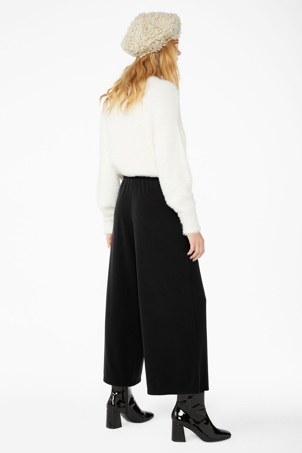 Model back image of Monki super-soft trousers in black