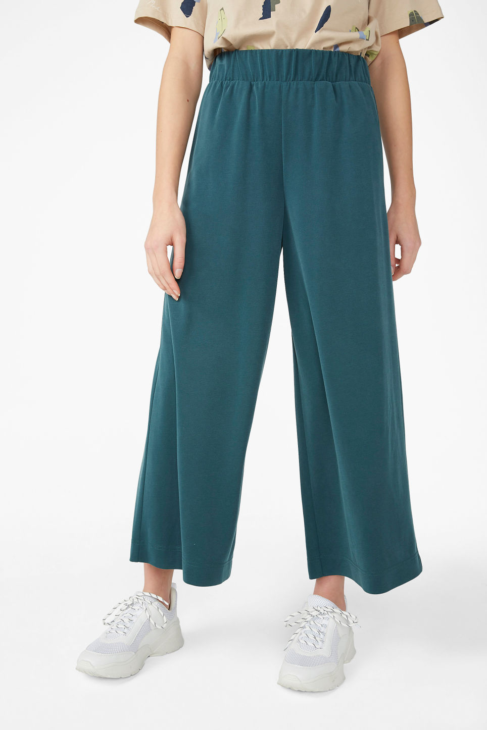 Model side image of Monki super-soft trousers in green