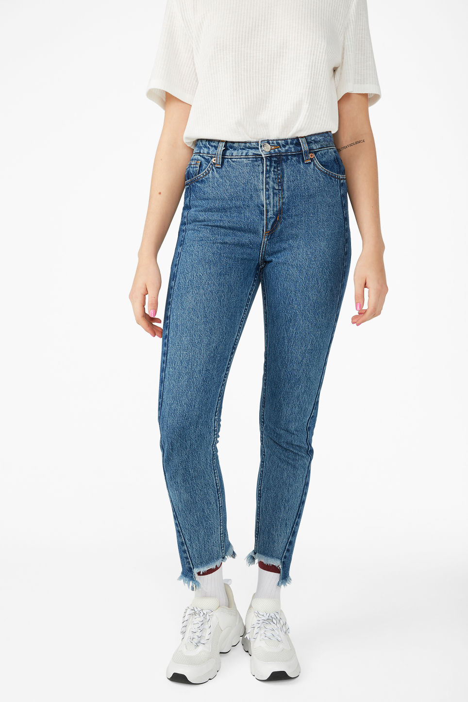 Model side image of Monki kimomo two shaded jeans in blue