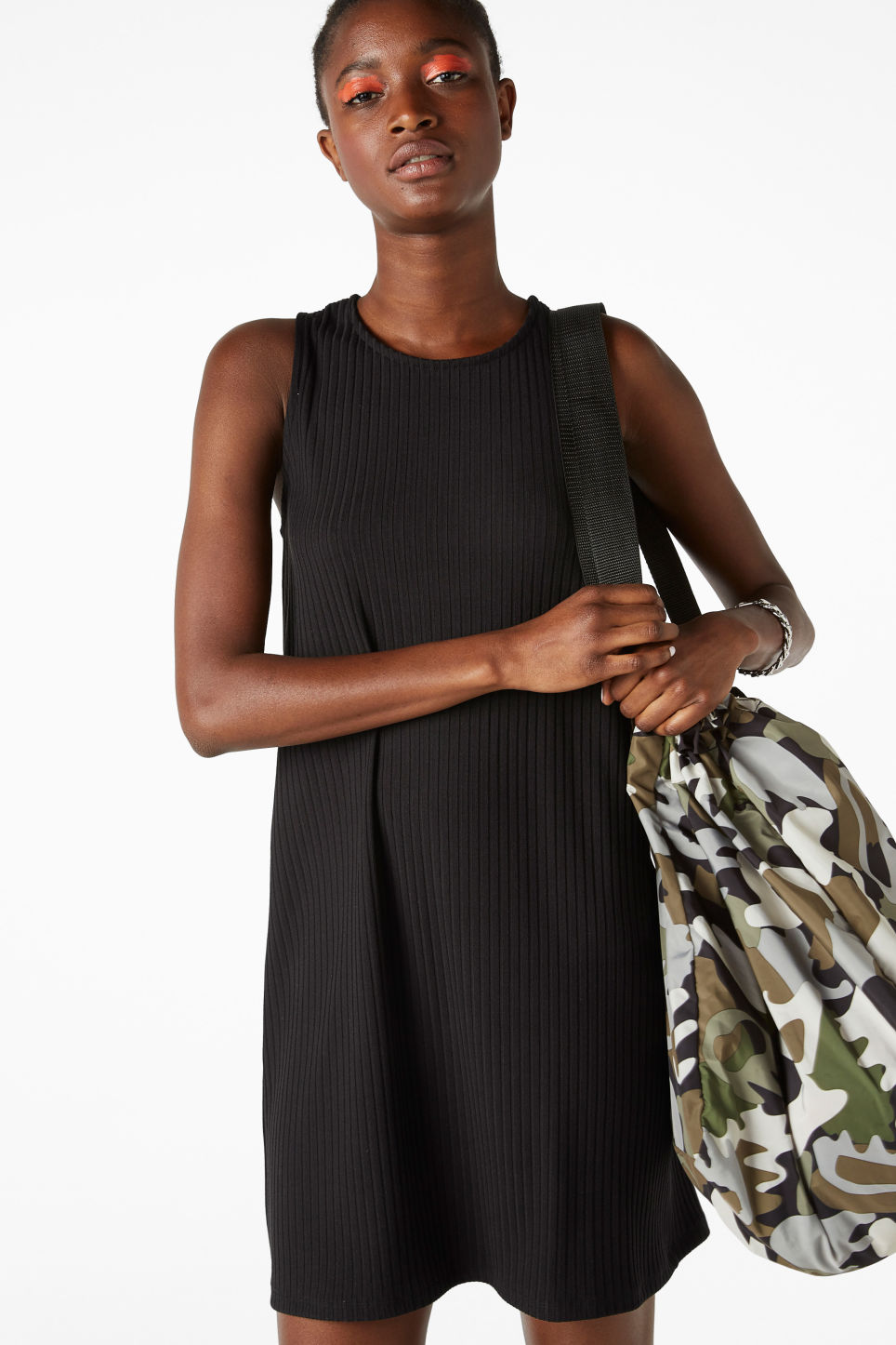 Model front image of Monki sleeveless dress with cross back in black
