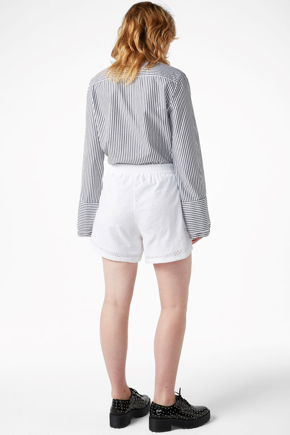 Model back image of Monki soft cotton shorts in white