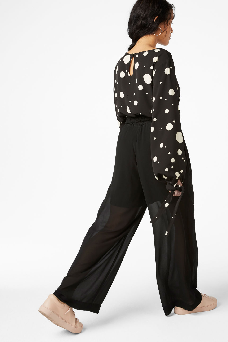 Model side image of Monki semi-sheer palazzo pants in black