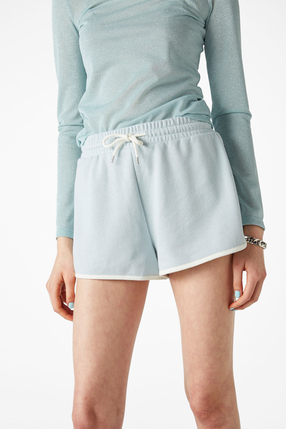 Model front image of Monki gym shorts in blue