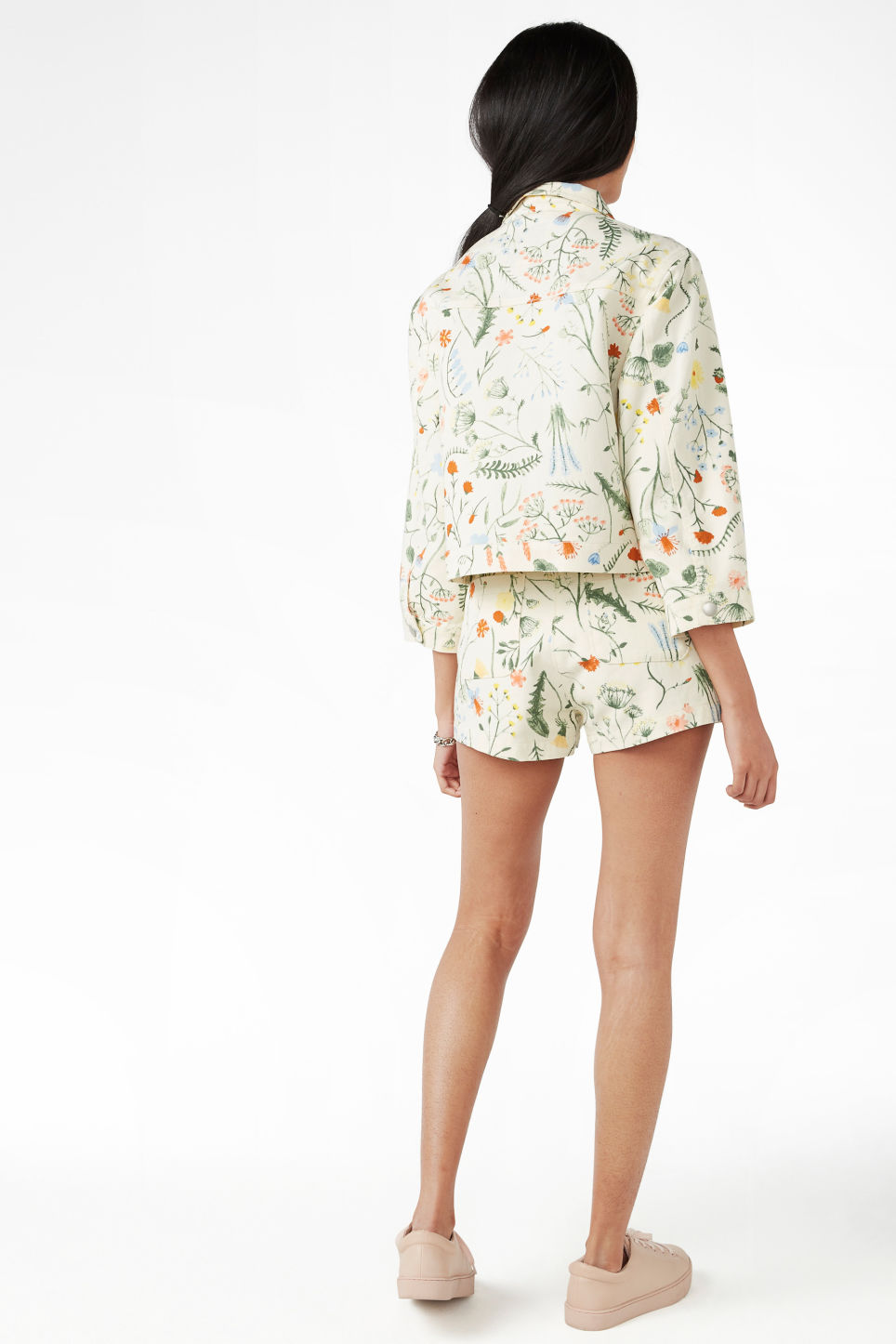 Model back image of Monki cropped floral denim jacket in white
