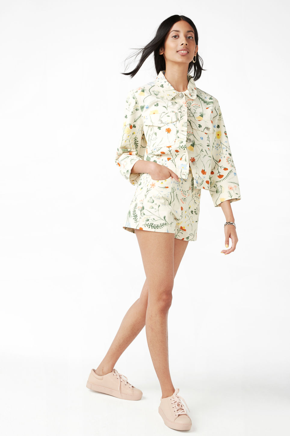 Model side image of Monki cropped floral denim jacket in white