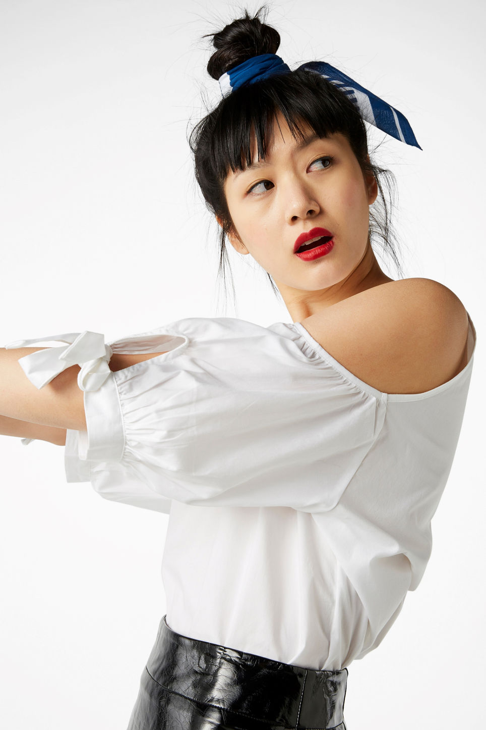Model side image of Monki cold shoulder blouse in white