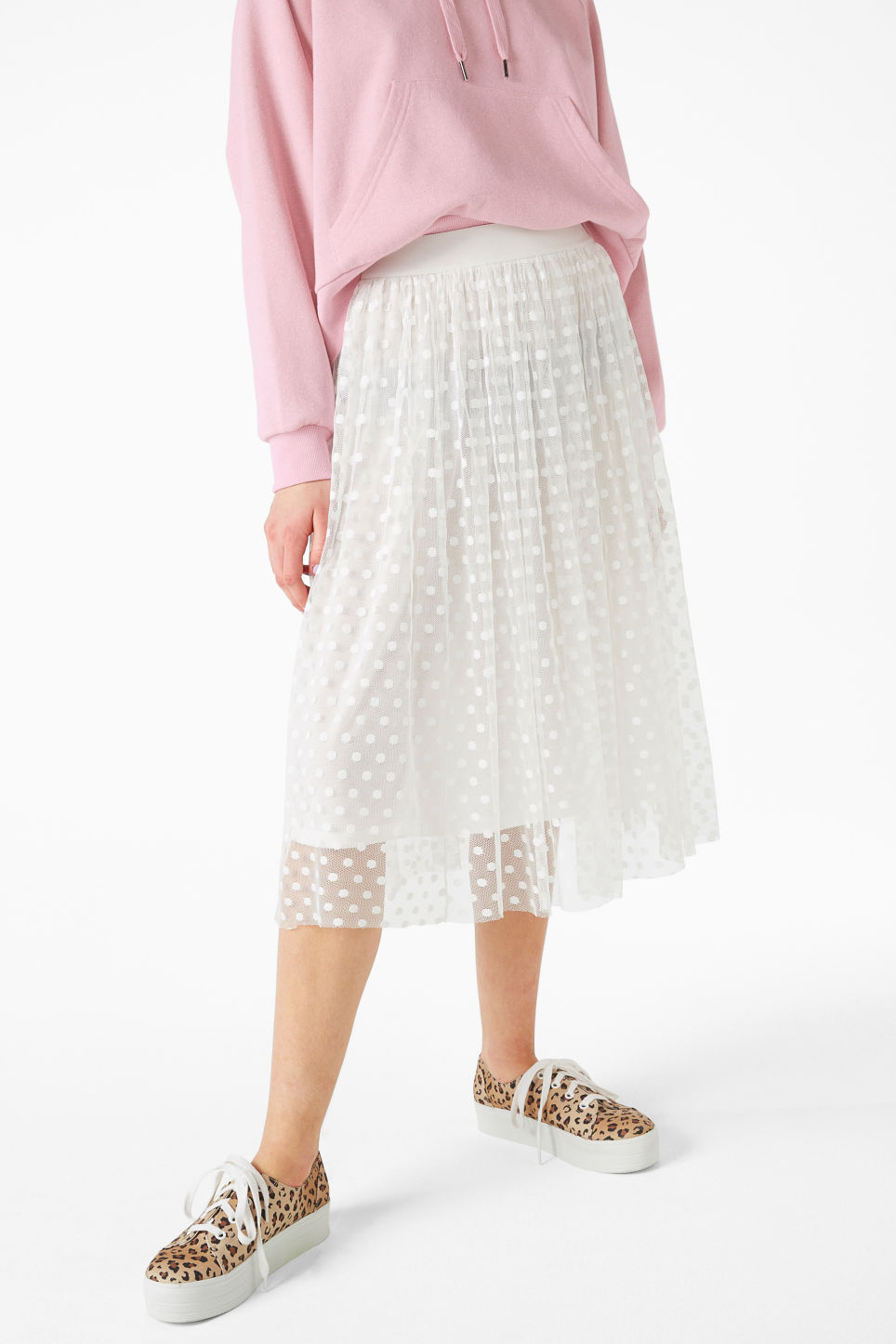Model side image of Monki polka dot lace skirt in white