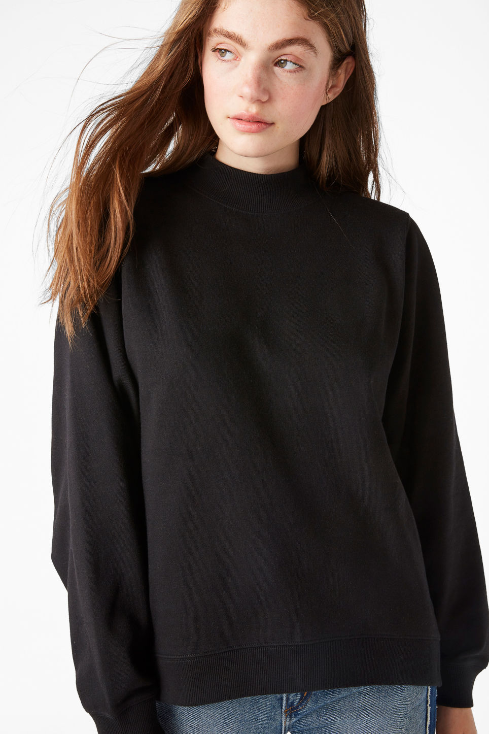 Model front image of Monki loose-fit sweater in black