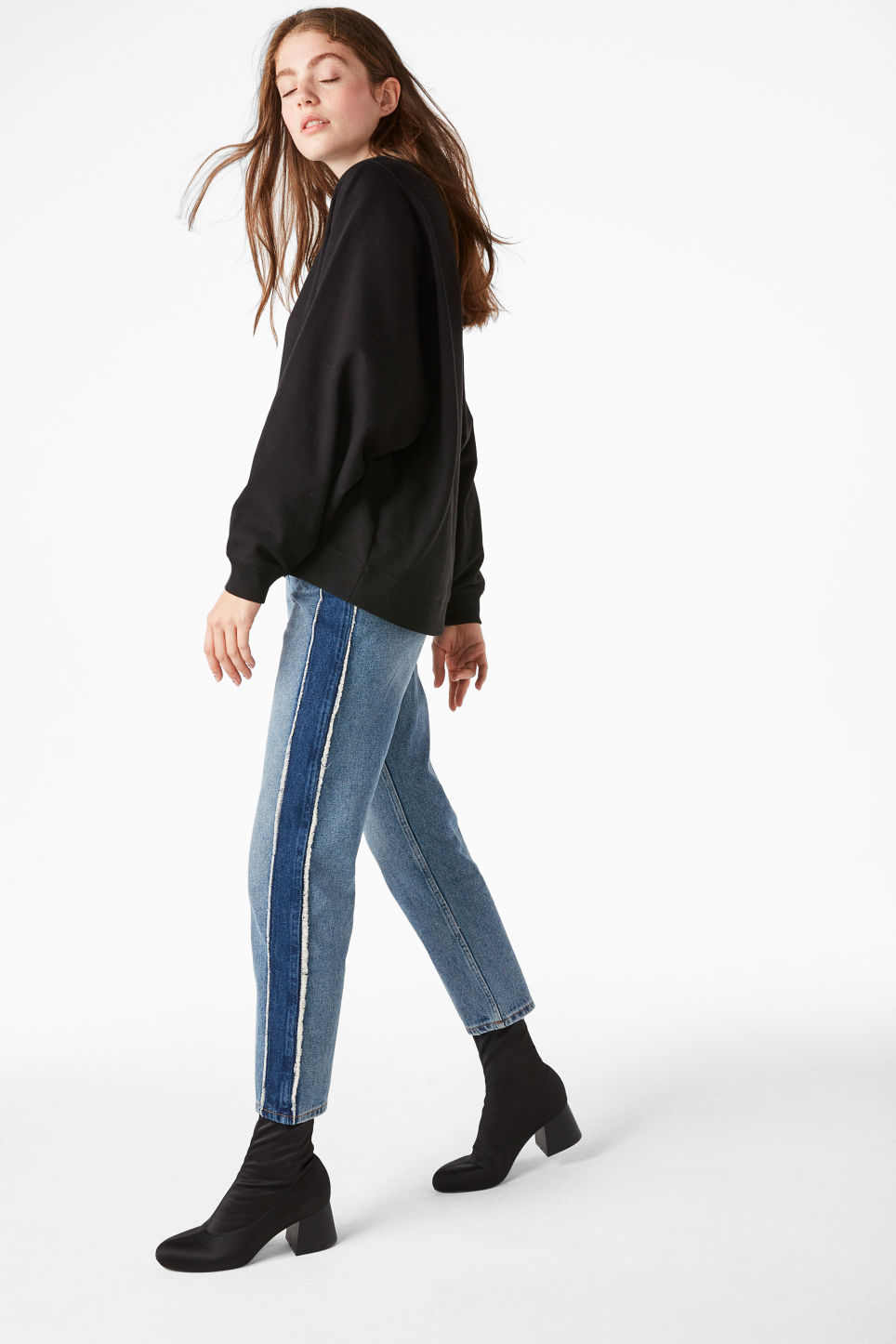Model side image of Monki loose-fit sweater in black