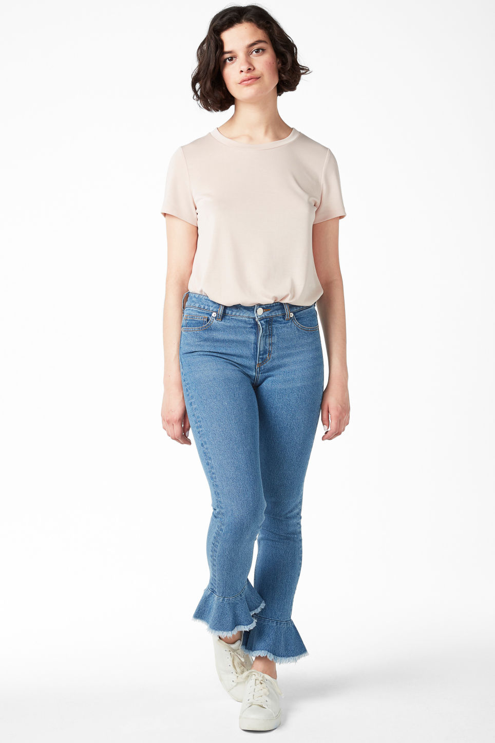 Model front image of Monki ruffled hem jeans  in blue