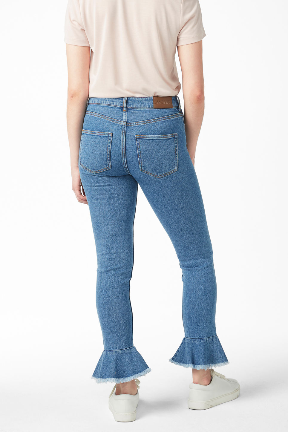 Model back image of Monki ruffled hem jeans  in blue