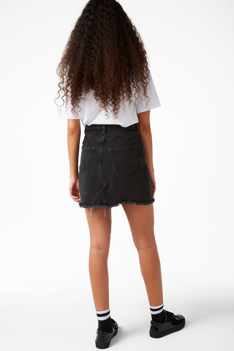 Model back image of Monki frayed hem denim skirt in black