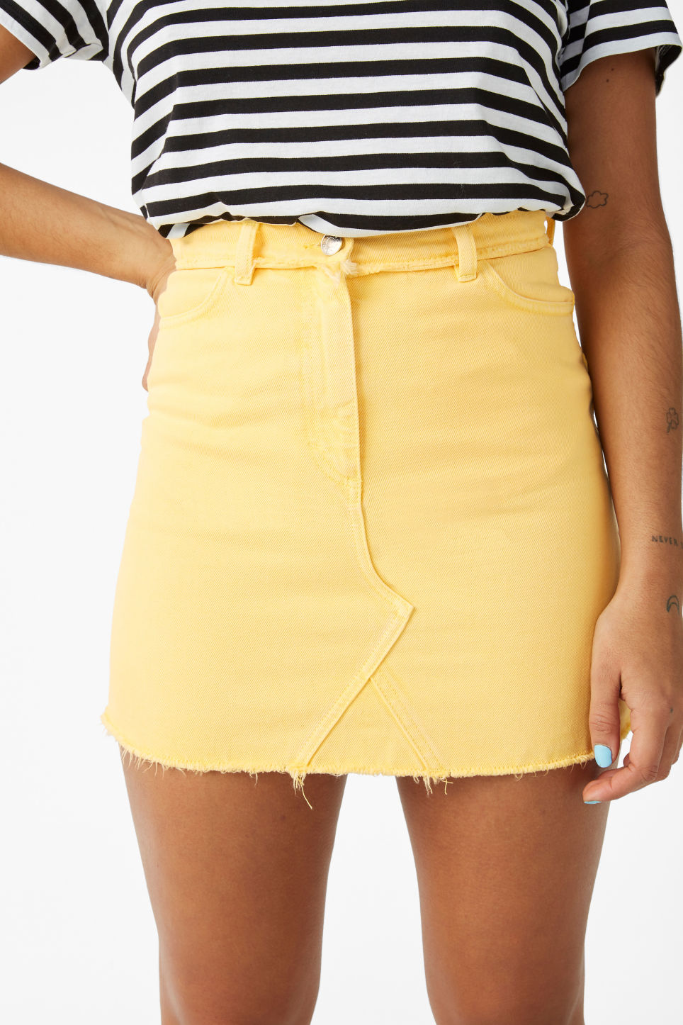 Model side image of Monki frayed hem denim skirt in yellow
