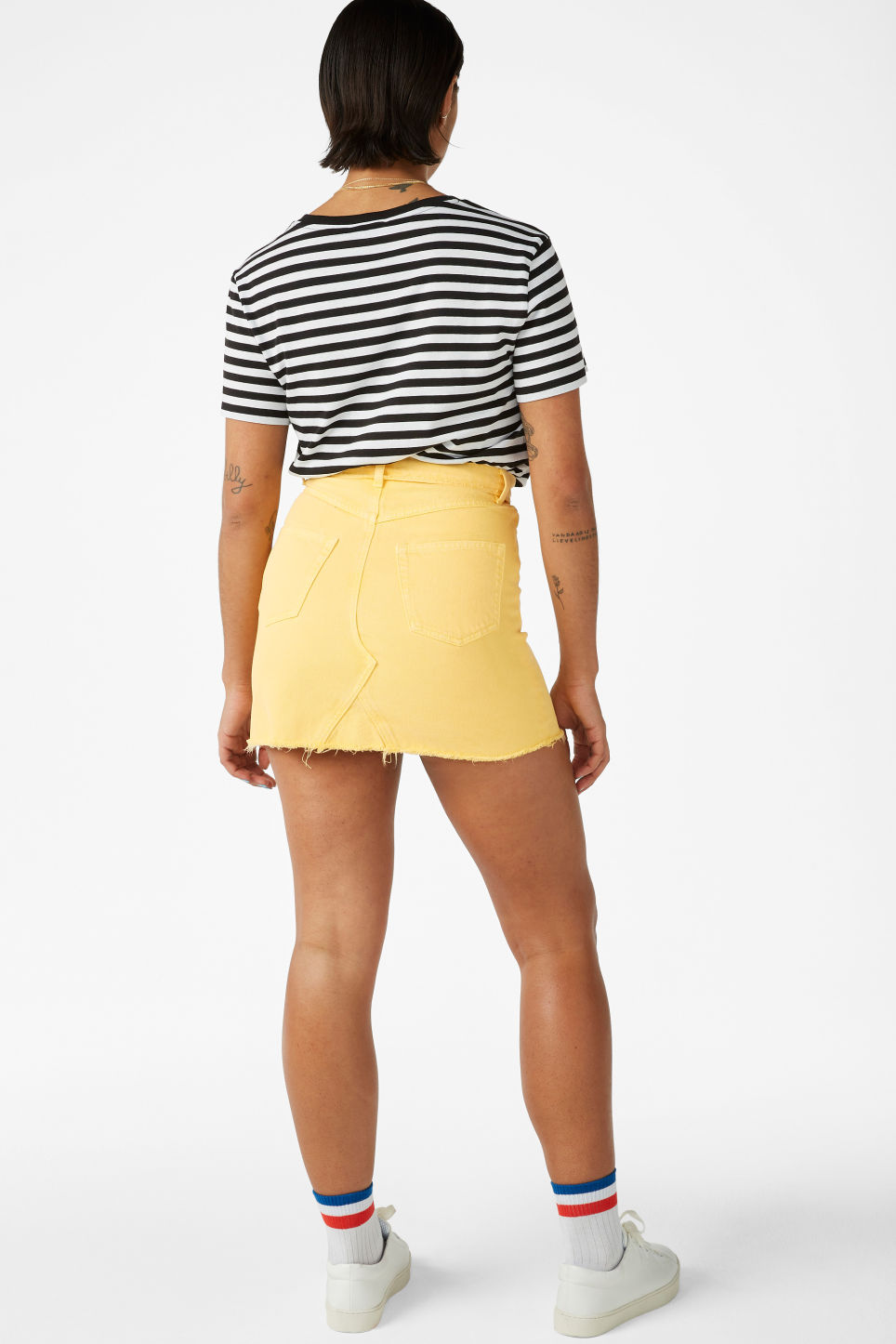 Model back image of Monki frayed hem denim skirt in yellow