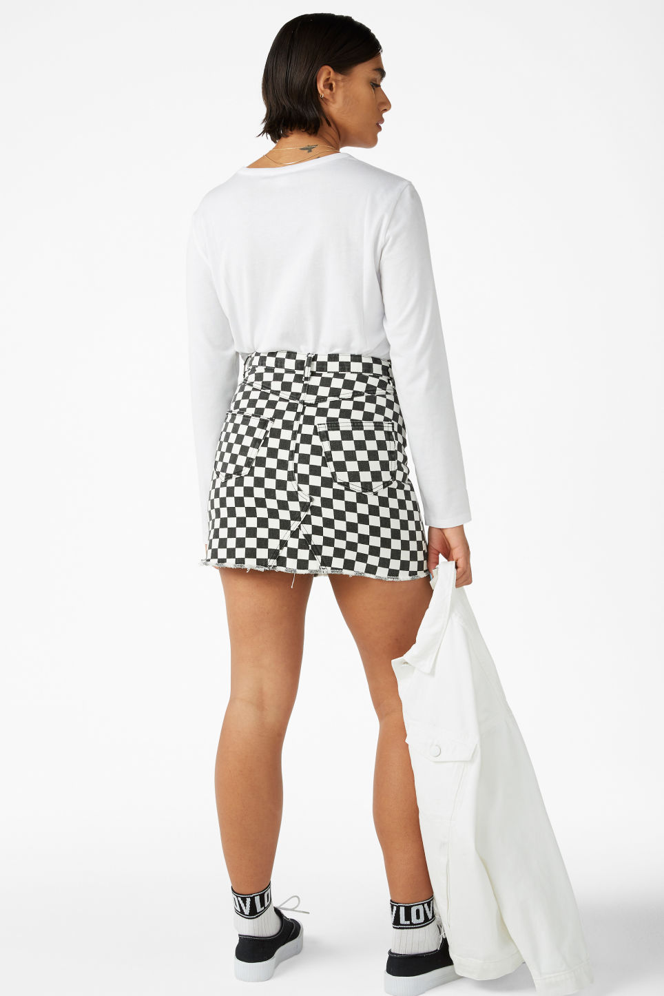 Model back image of Monki frayed hem denim skirt in white