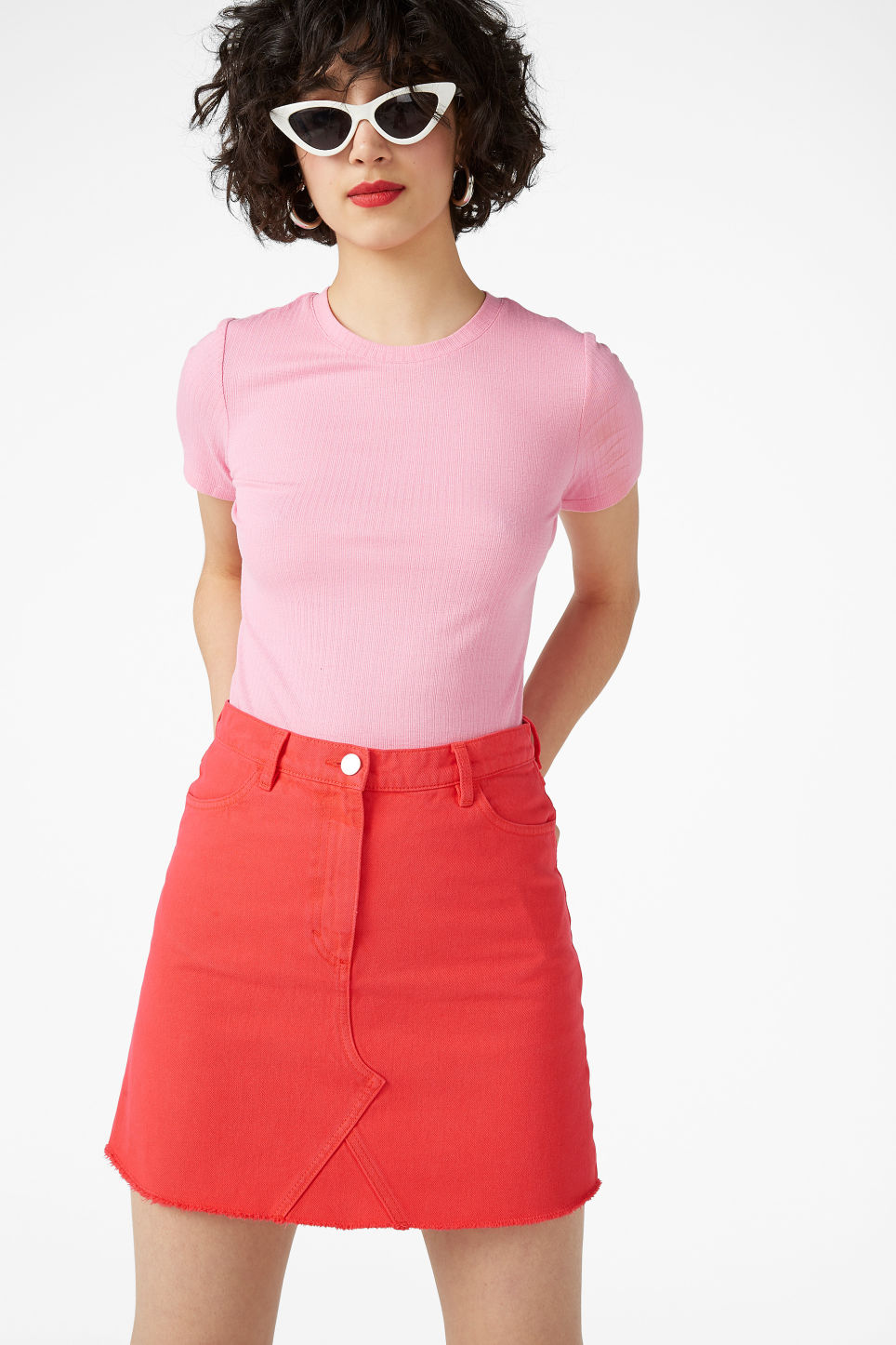 Model front image of Monki frayed hem denim skirt in red