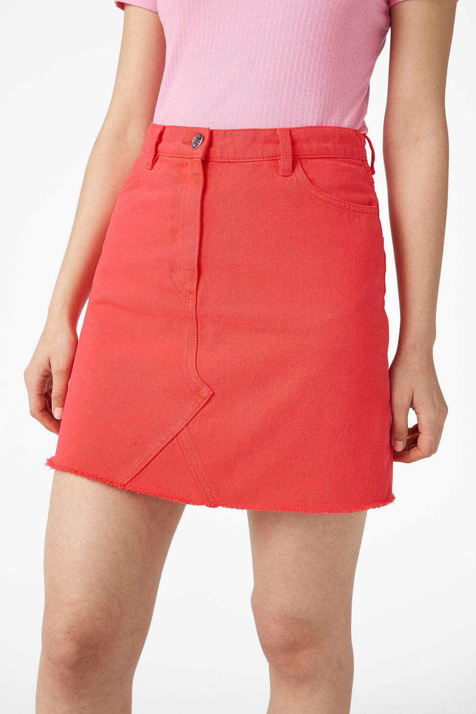 Model side image of Monki frayed hem denim skirt in red