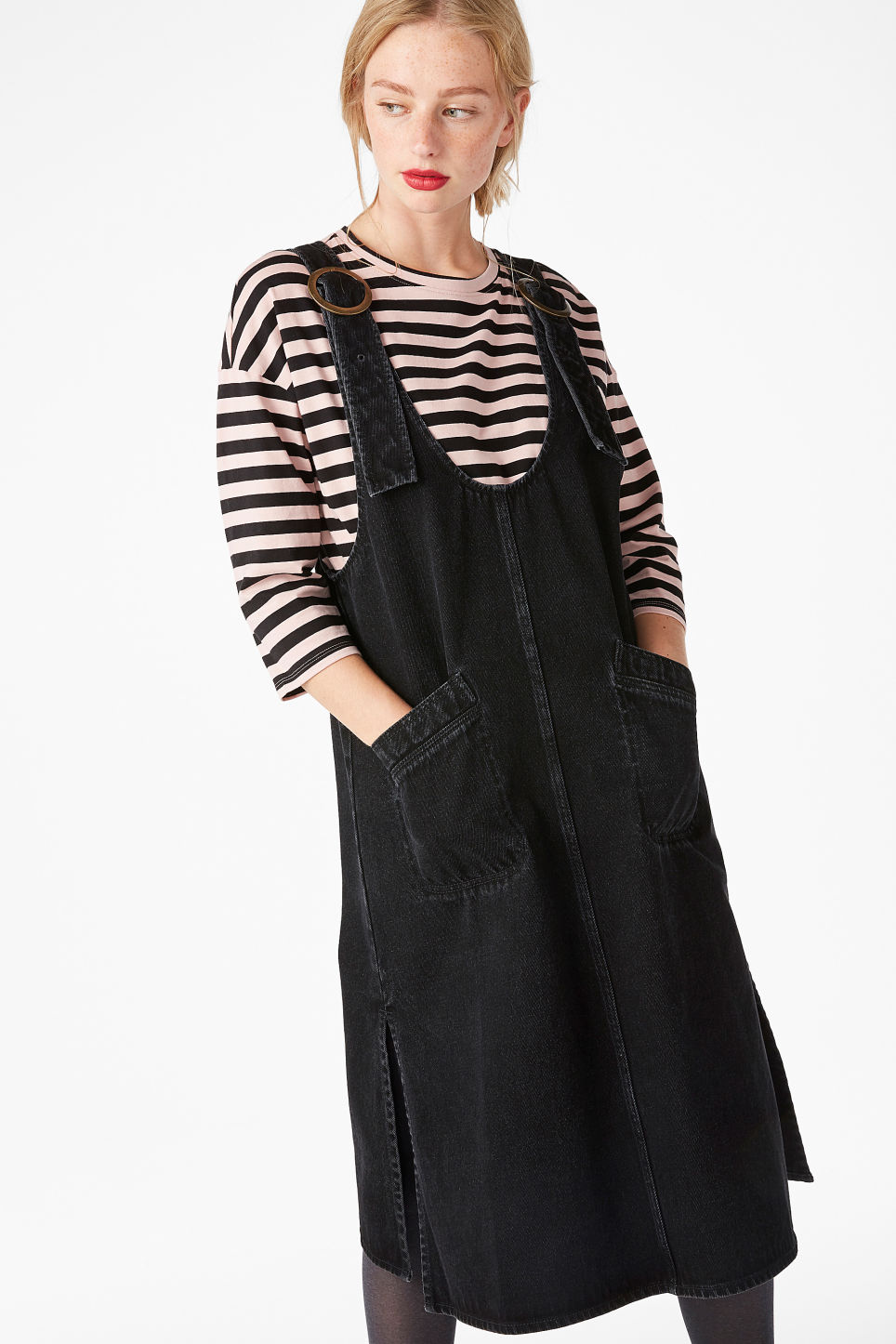 Model side image of Monki long denim pinafore dress in black