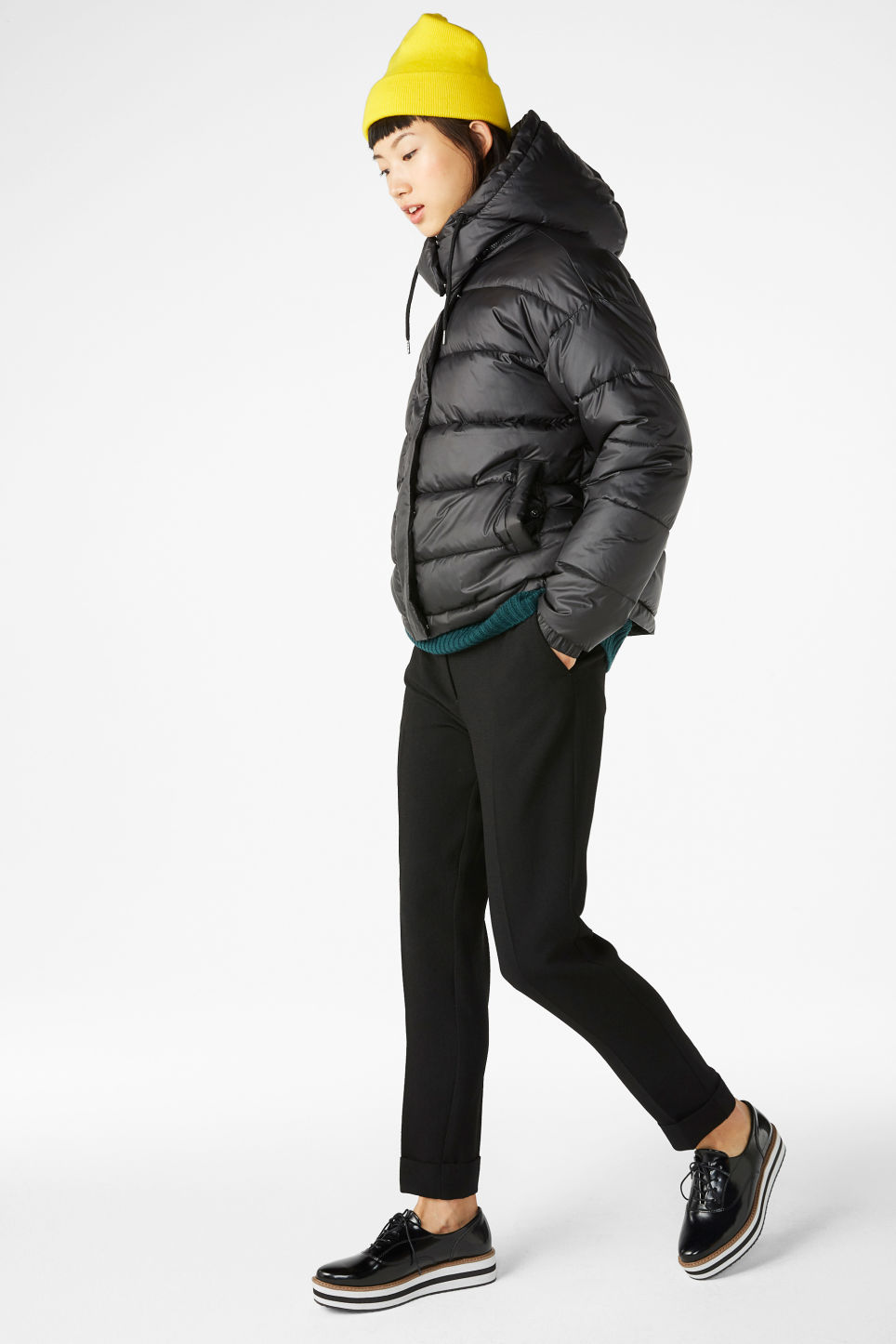 Model side image of Monki hooded puffer jacket in black