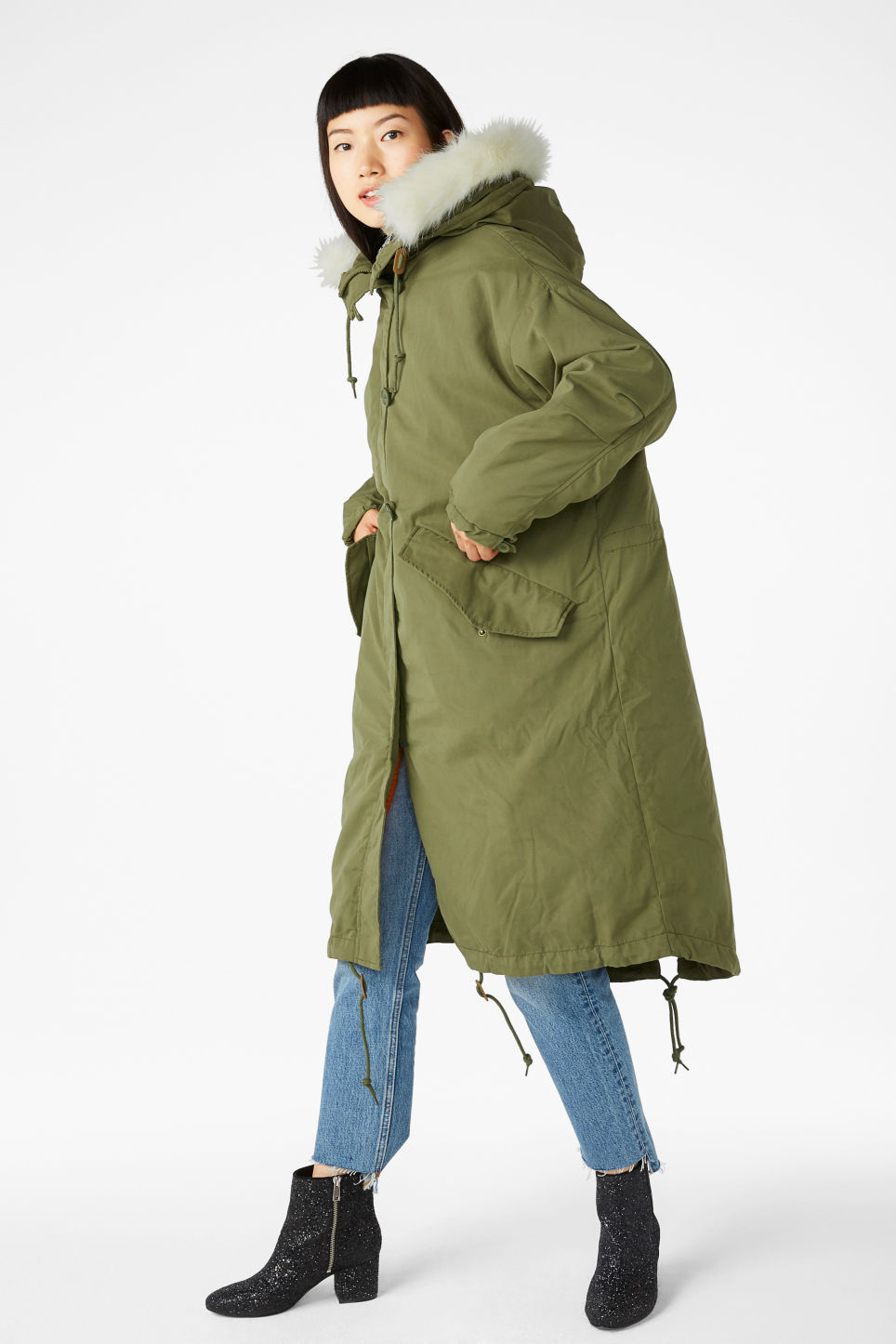 Model side image of Monki hooded coat with detachable lining in green