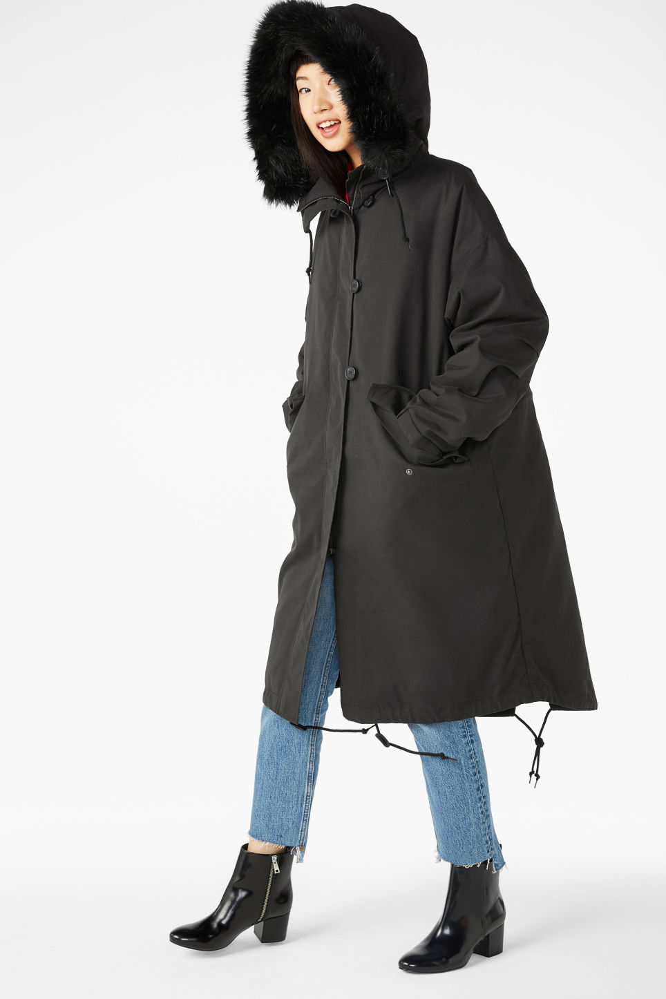 Model side image of Monki hooded coat with detachable lining in black