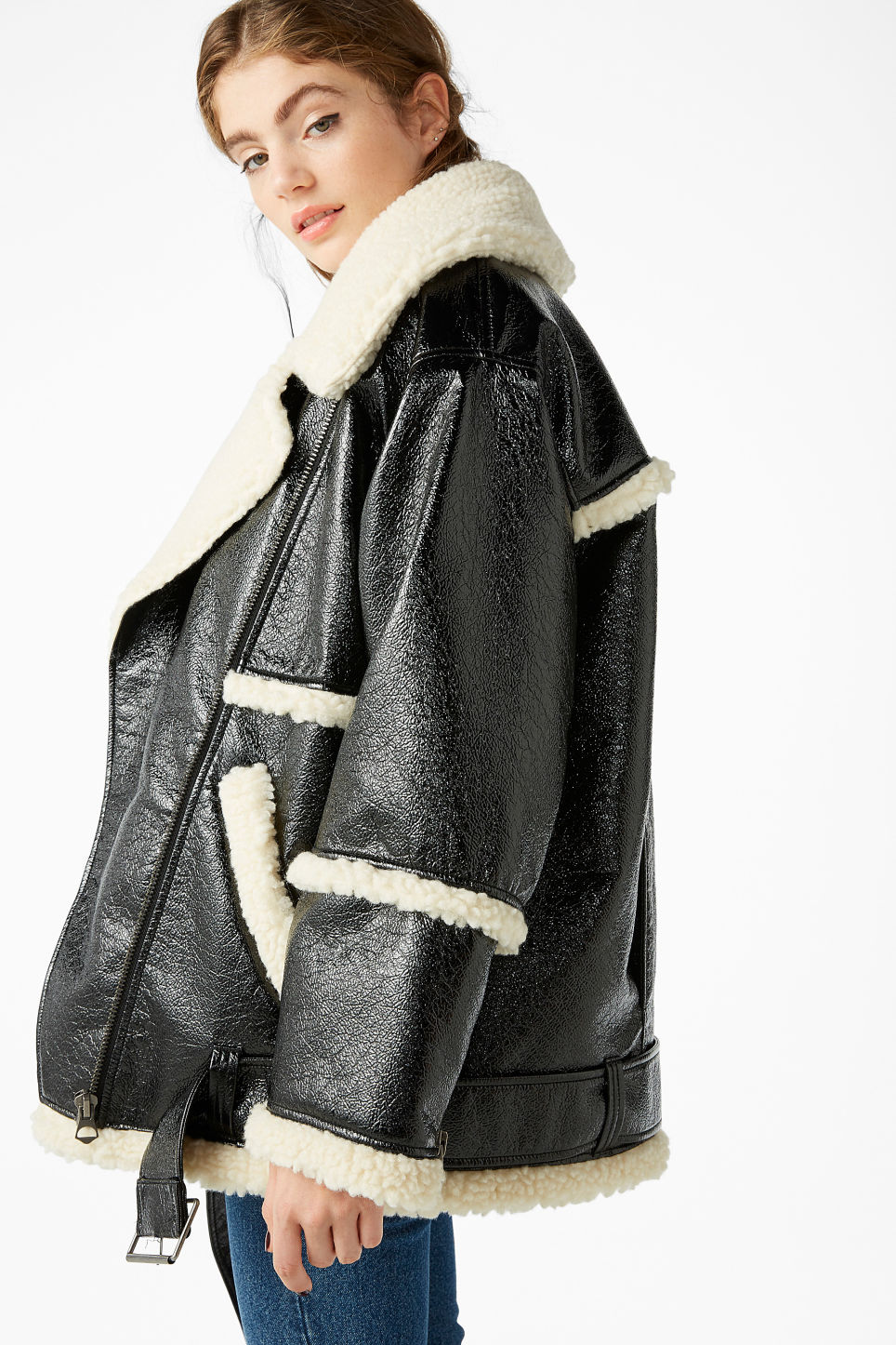 Model side image of Monki statement aviator jacket in black
