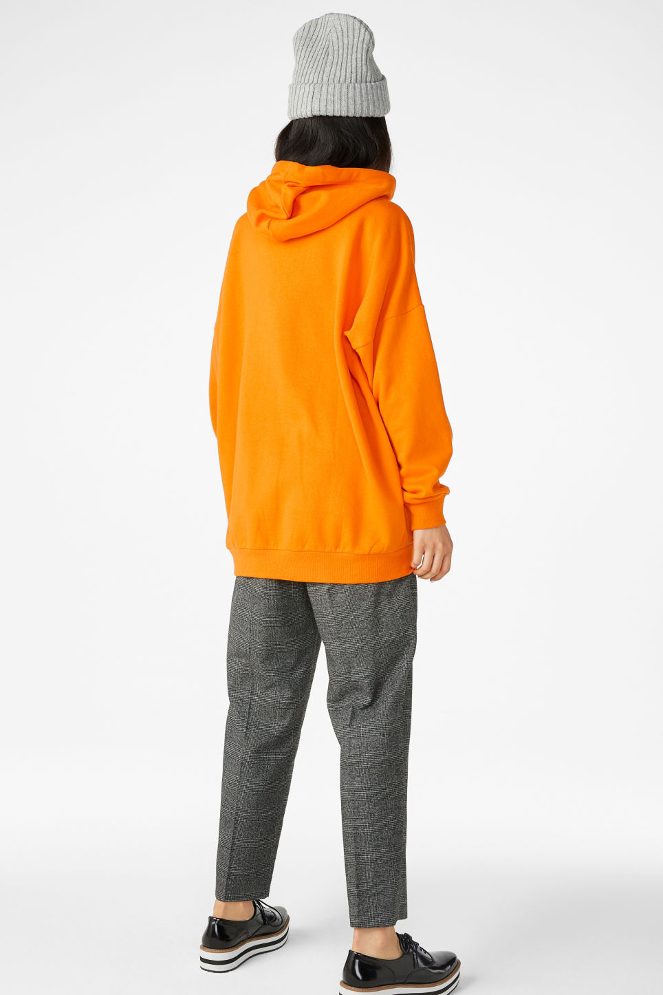 Model back image of Monki oversized hoodie in orange