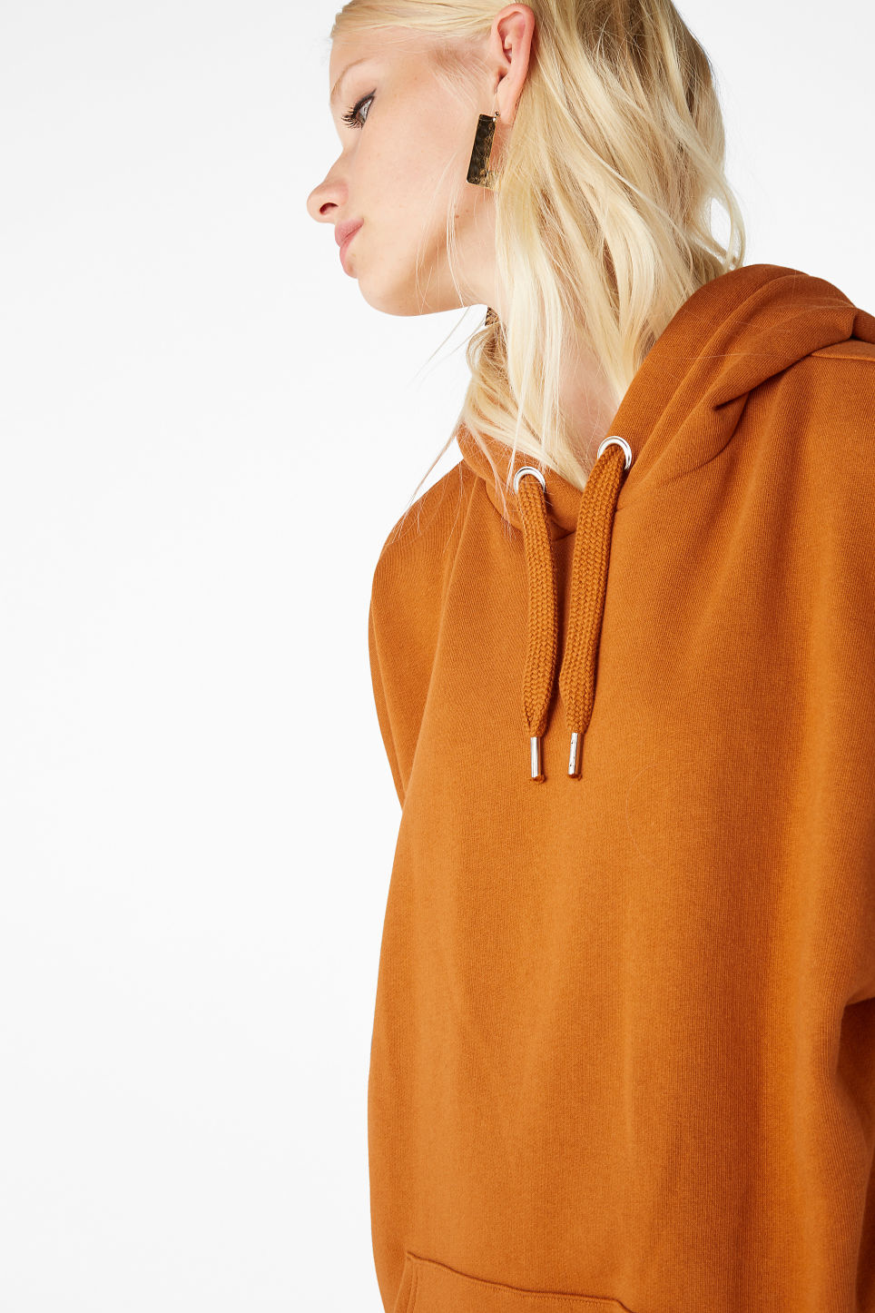 Model side image of Monki oversized hoodie in orange