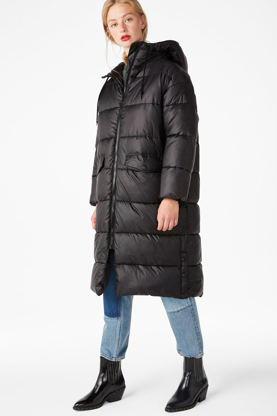 Model side image of Monki oversized puffer coat in black