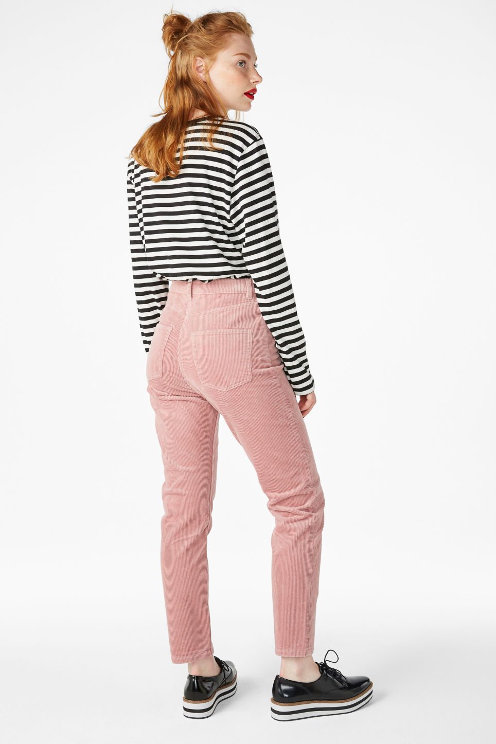 Model side image of Monki corduroy  trousers in pink