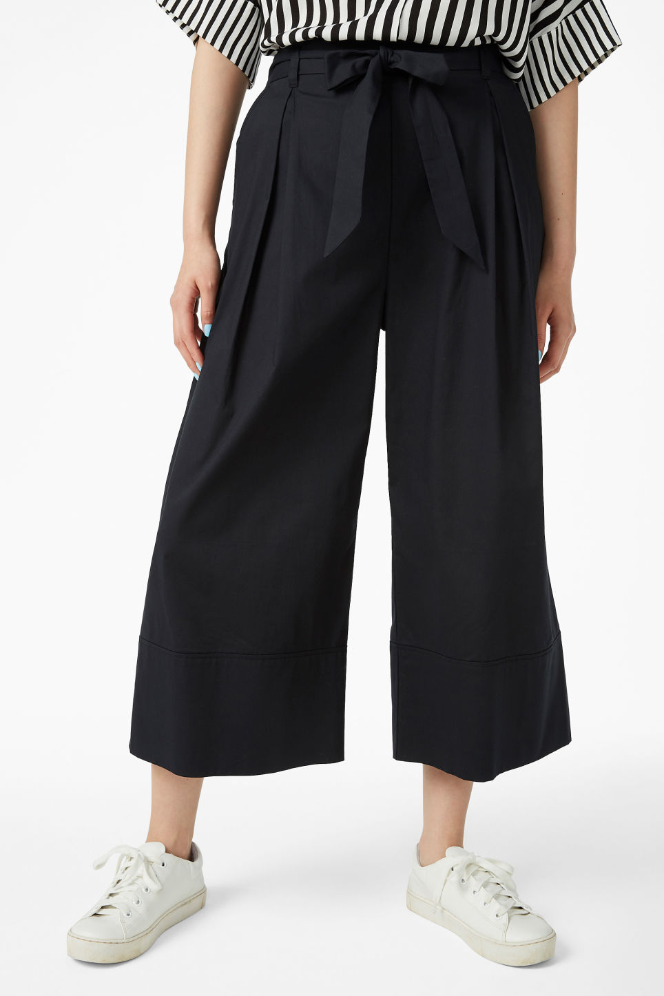 Model side image of Monki culottes with paper bag waist in black