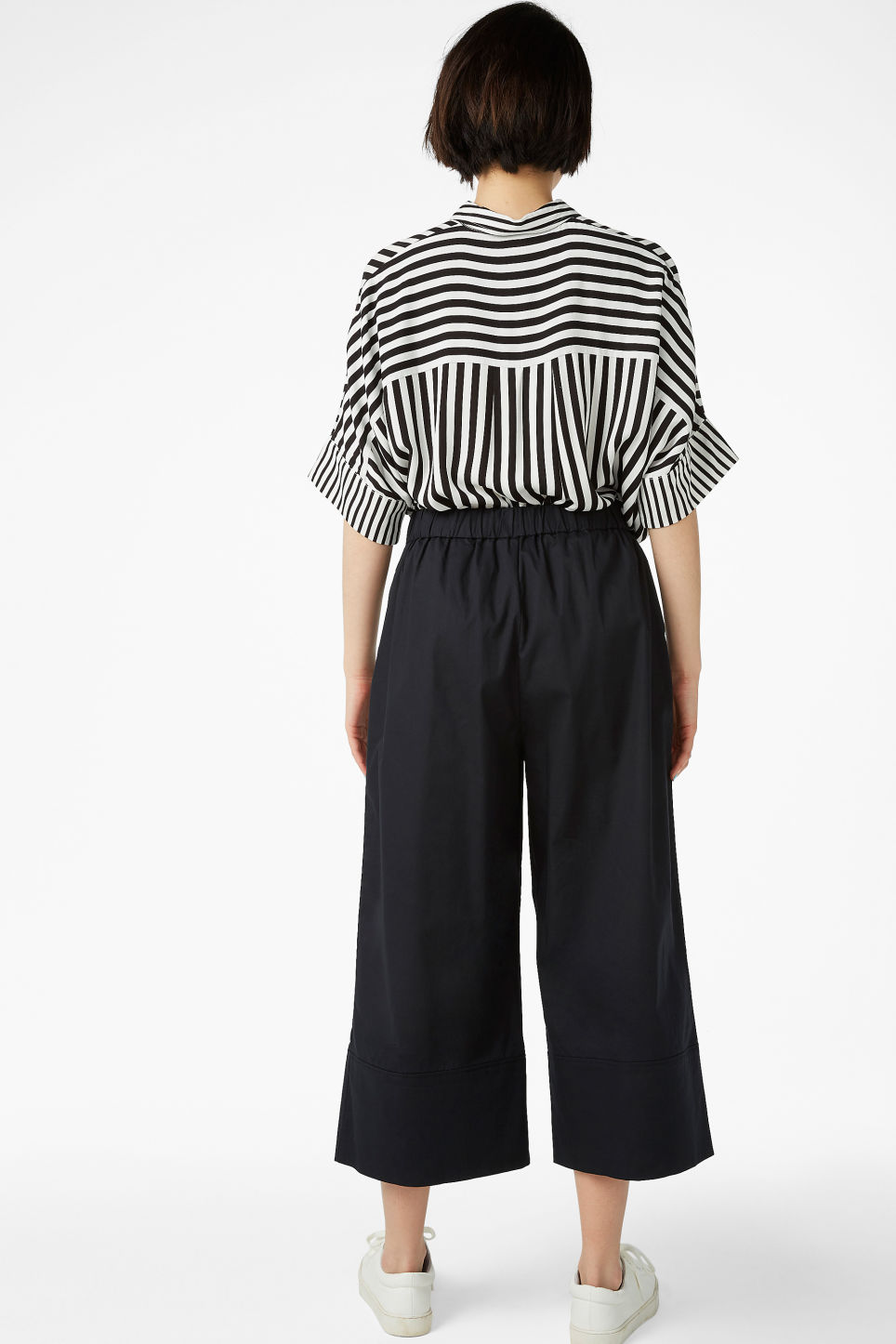 Model back image of Monki culottes with paper bag waist in black