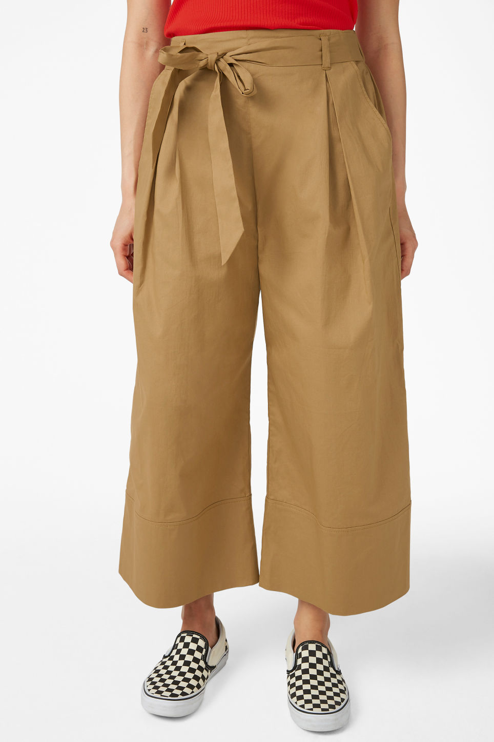 Model side image of Monki culottes with paper bag waist in beige