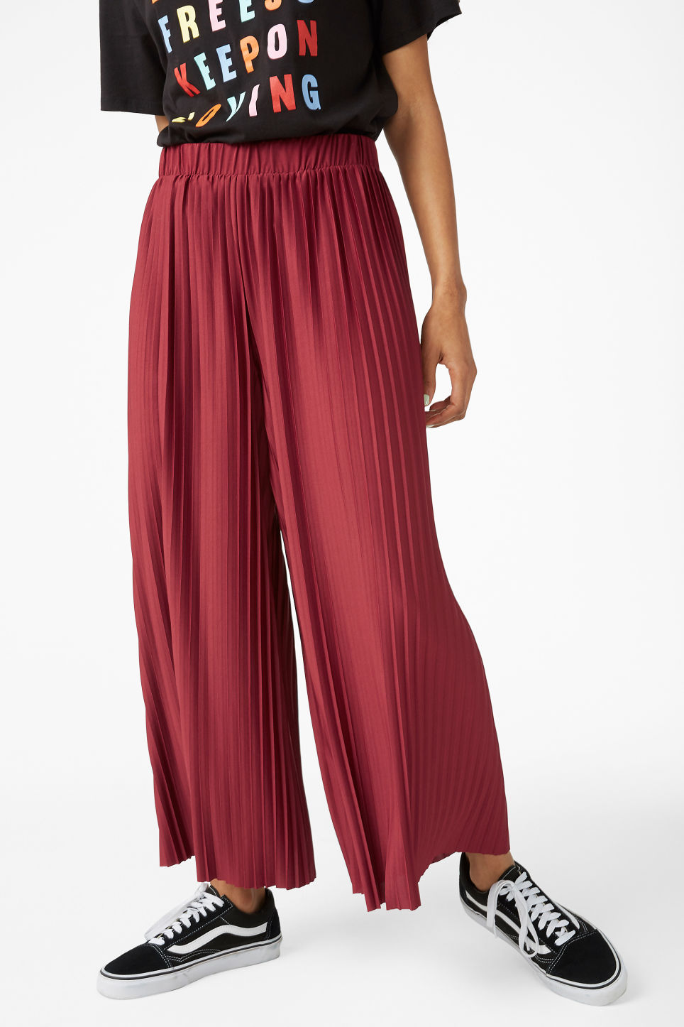 Model side image of Monki wide leg pleated trousers in red