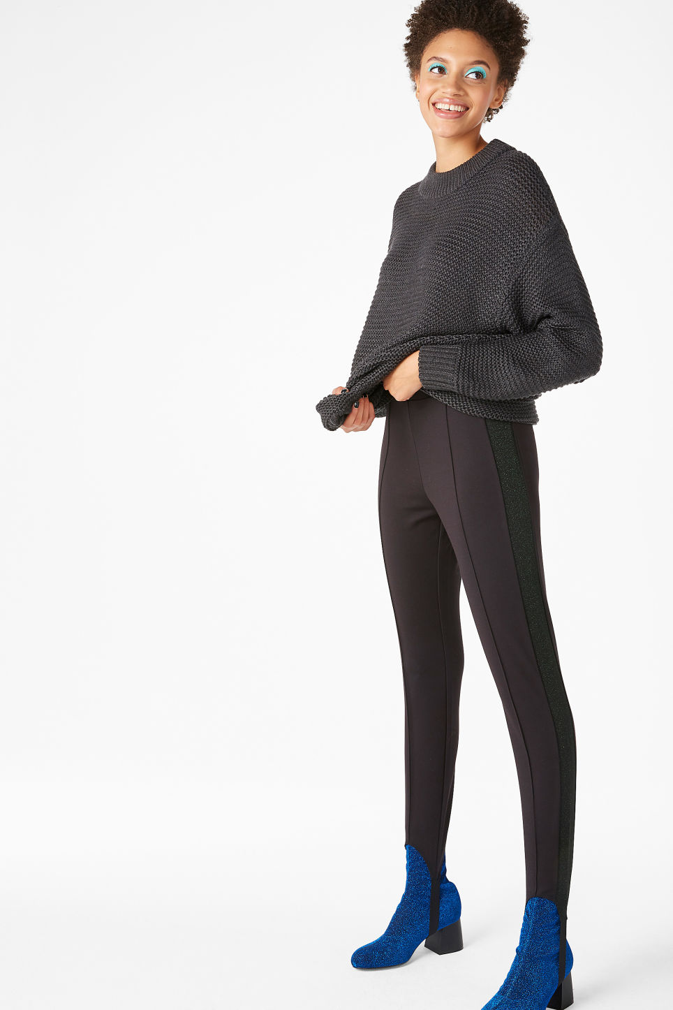 Model side image of Monki fancy leggings in black