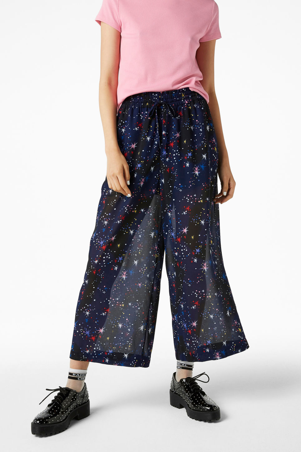 Model front image of Monki semi-sheer palazzo trousers in blue