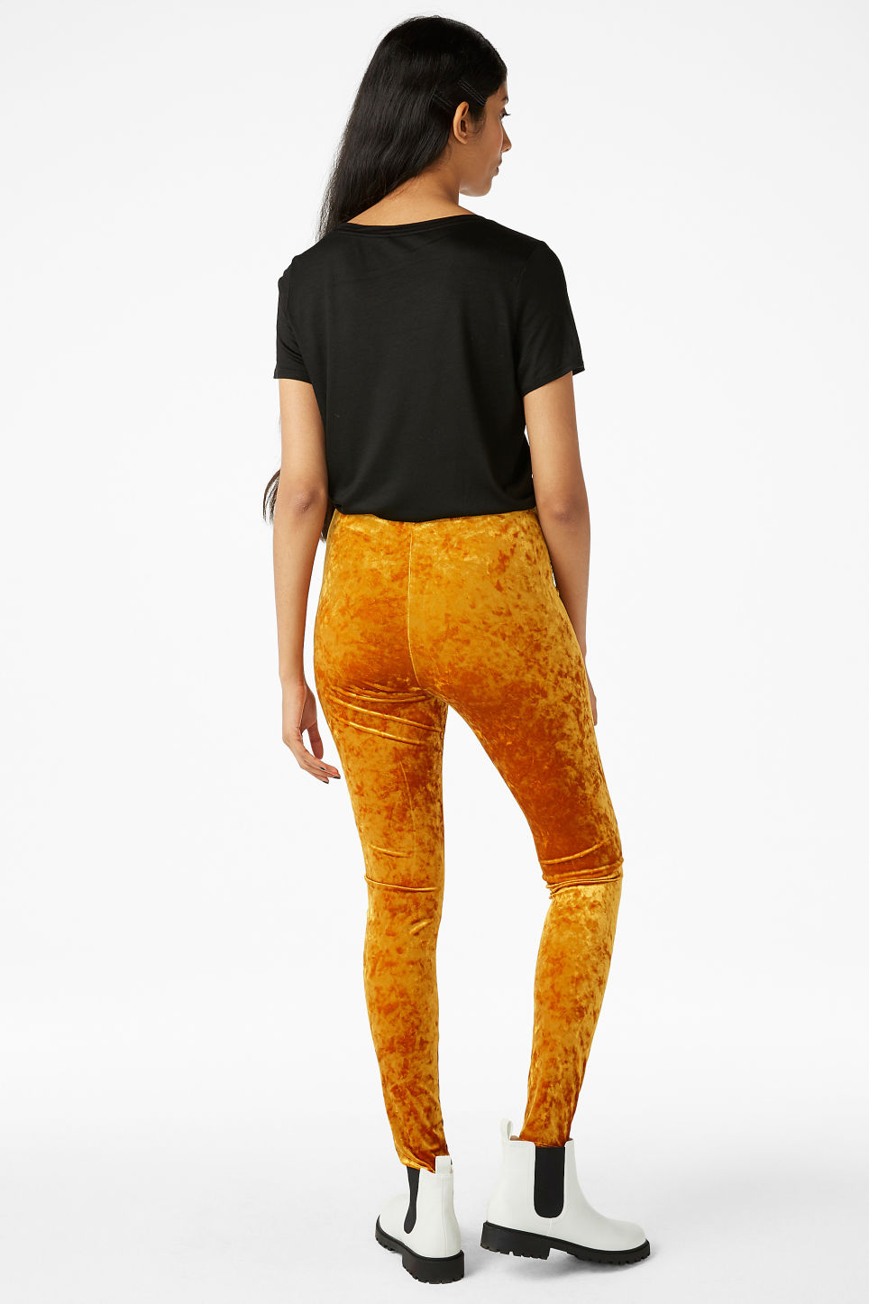 Model back image of Monki velvet leggings in orange