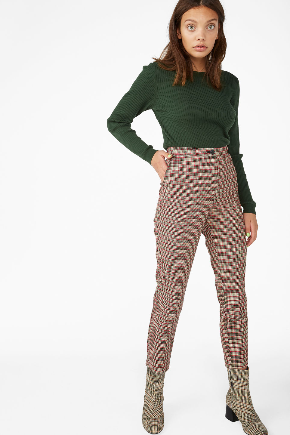 Model side image of Monki knitted long-sleeved top in green