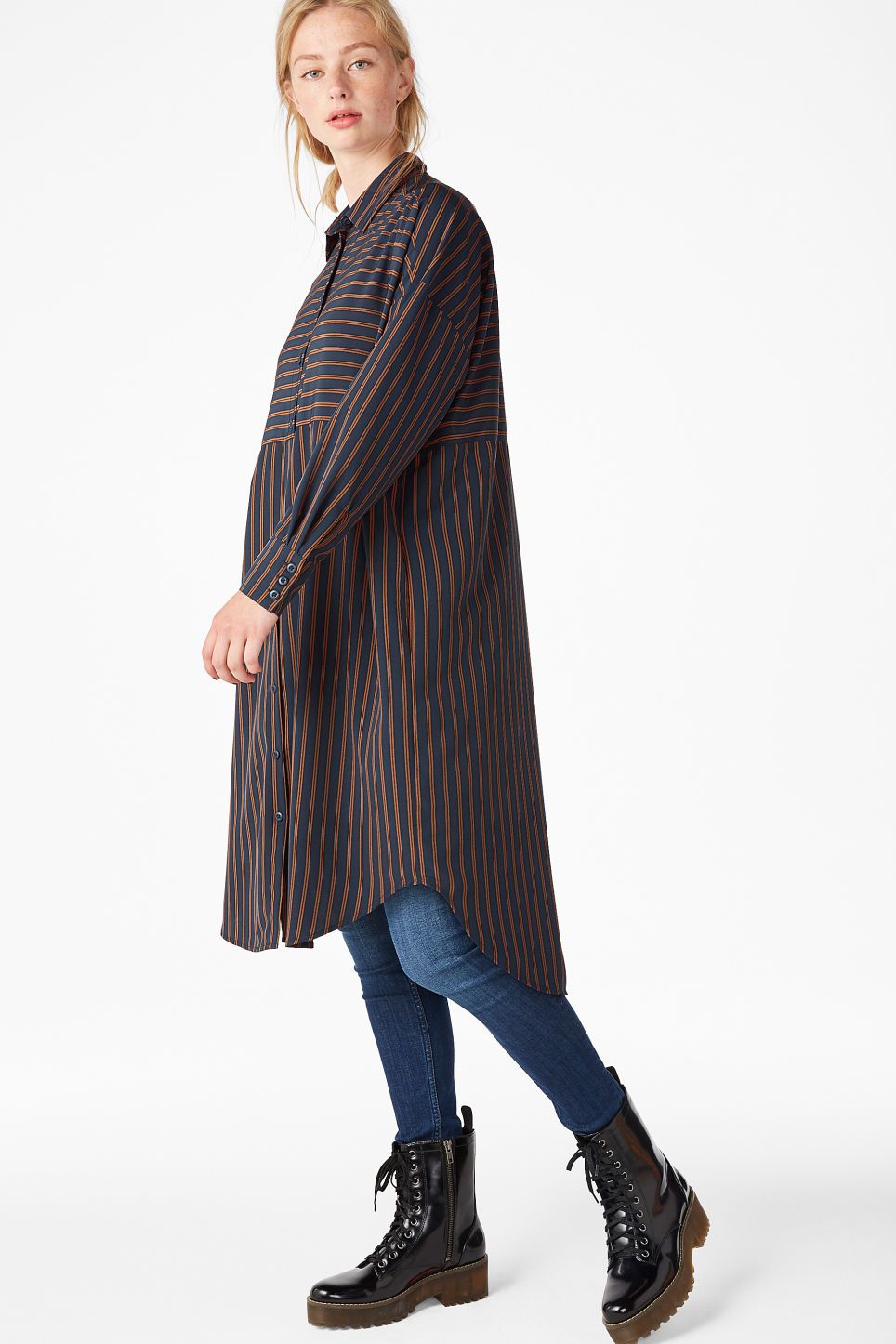 Model side image of Monki oversized shirt dress in blue