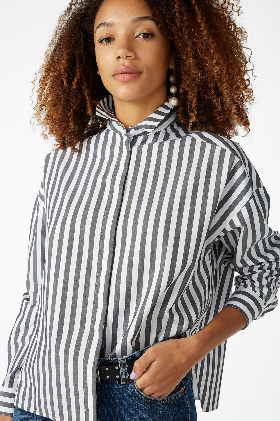 Model front image of Monki hidden button cotton blouse in black