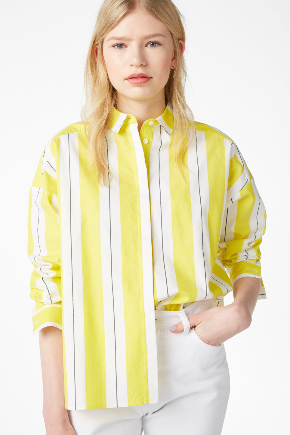 Model front image of Monki hidden button cotton blouse in yellow