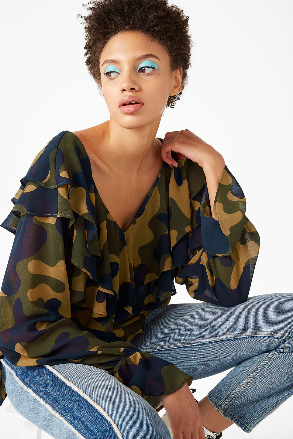 Model front image of Monki printed ruffle blouse in green