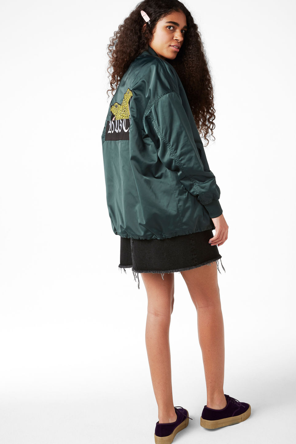 Model side image of Monki embroidered satin bomber jacket in turquoise