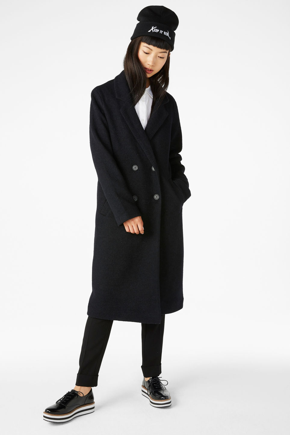 Model front image of Monki double-breasted coat in black