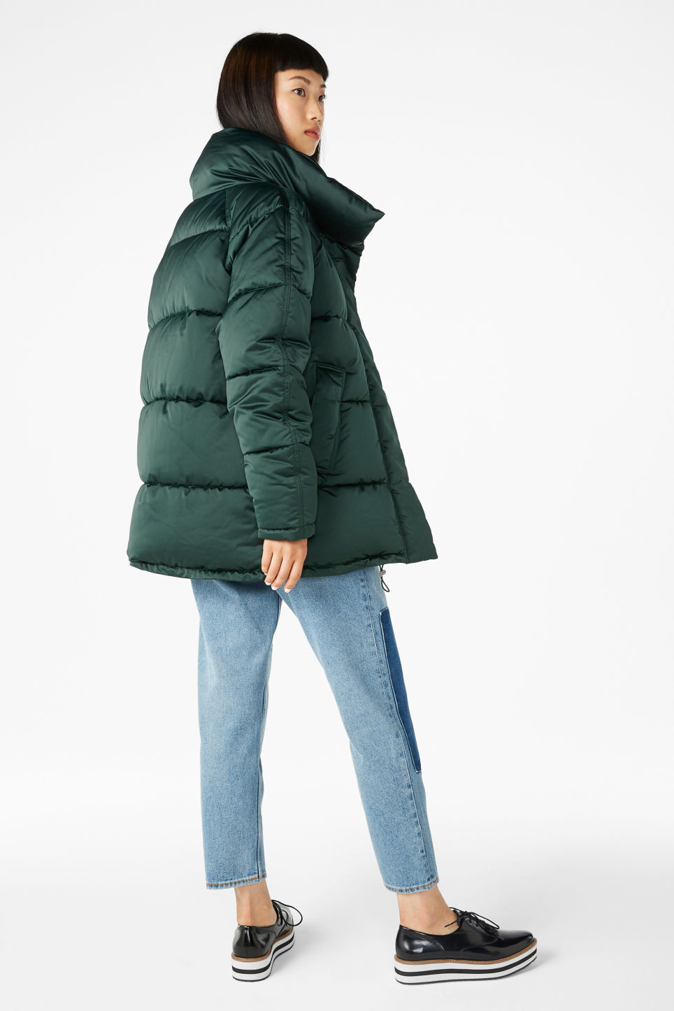 Model side image of Monki puffer jacket in turquoise