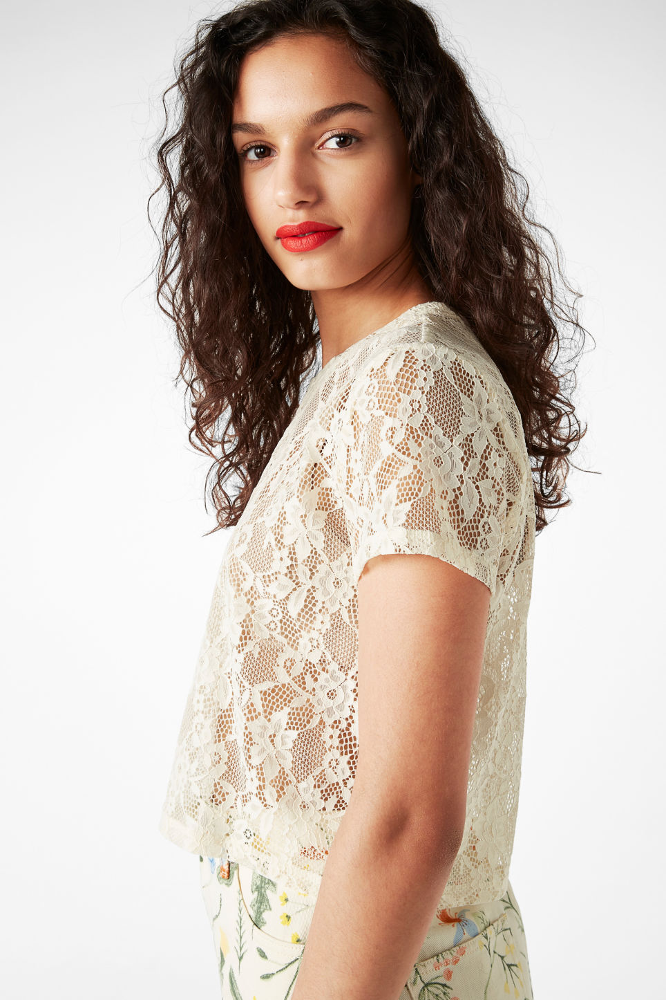 Model side image of Monki lace cropped tee in white