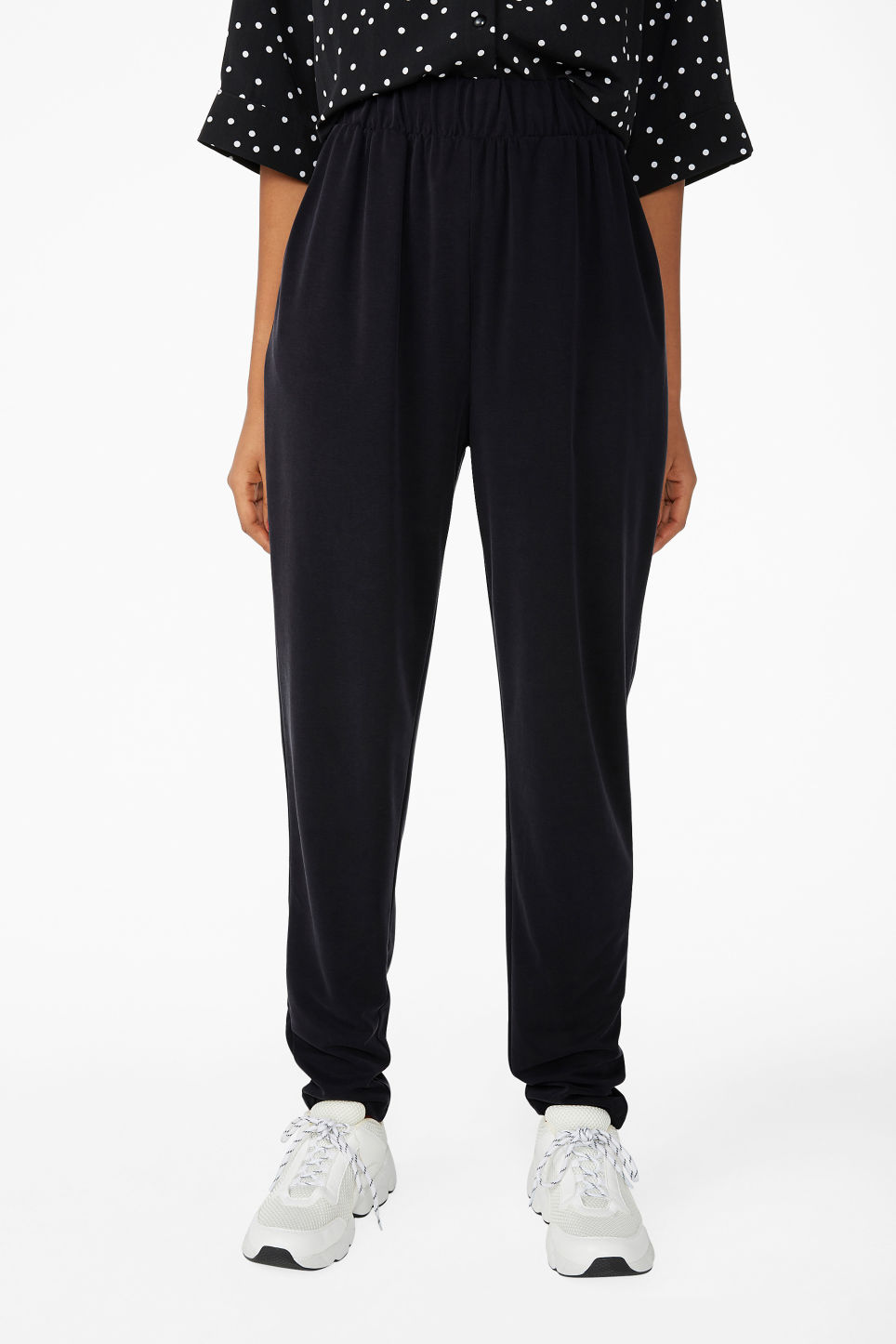 Model side image of Monki super-soft lounge pants in black