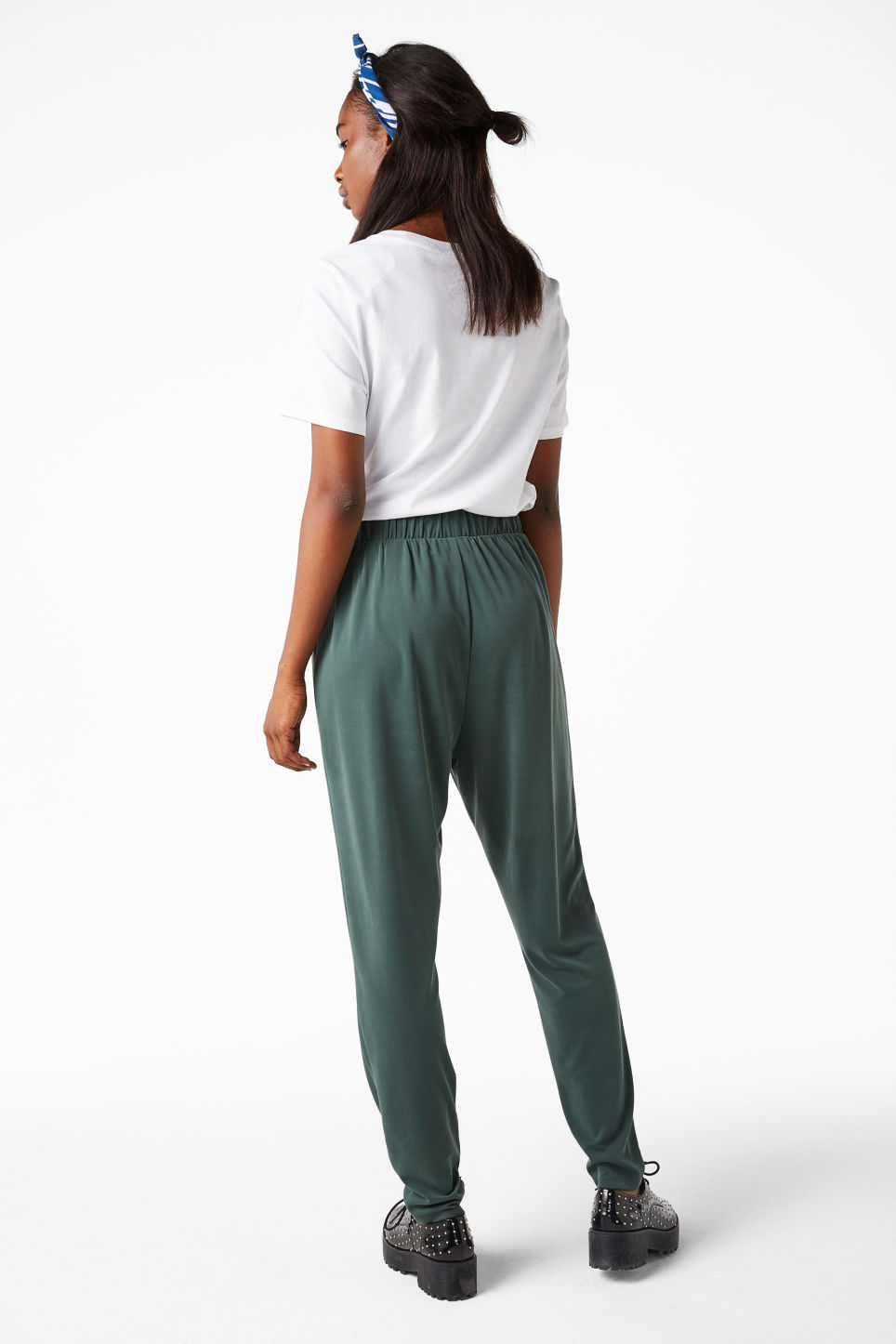 Model side image of Monki super-soft lounge pants in green