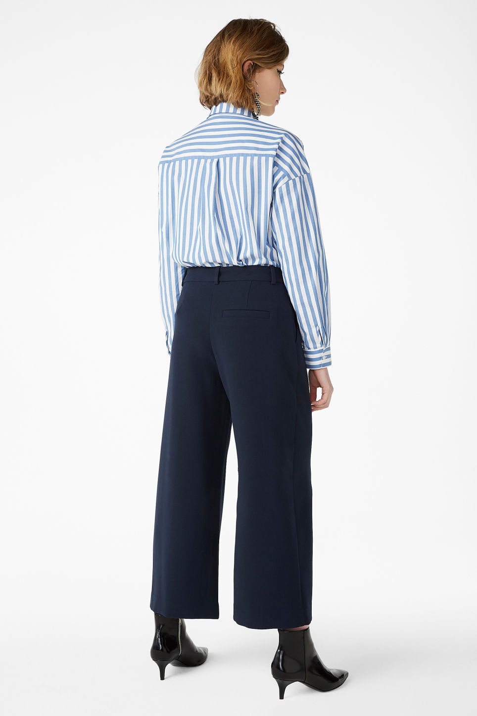 Model back image of Monki wide leg trousers in blue