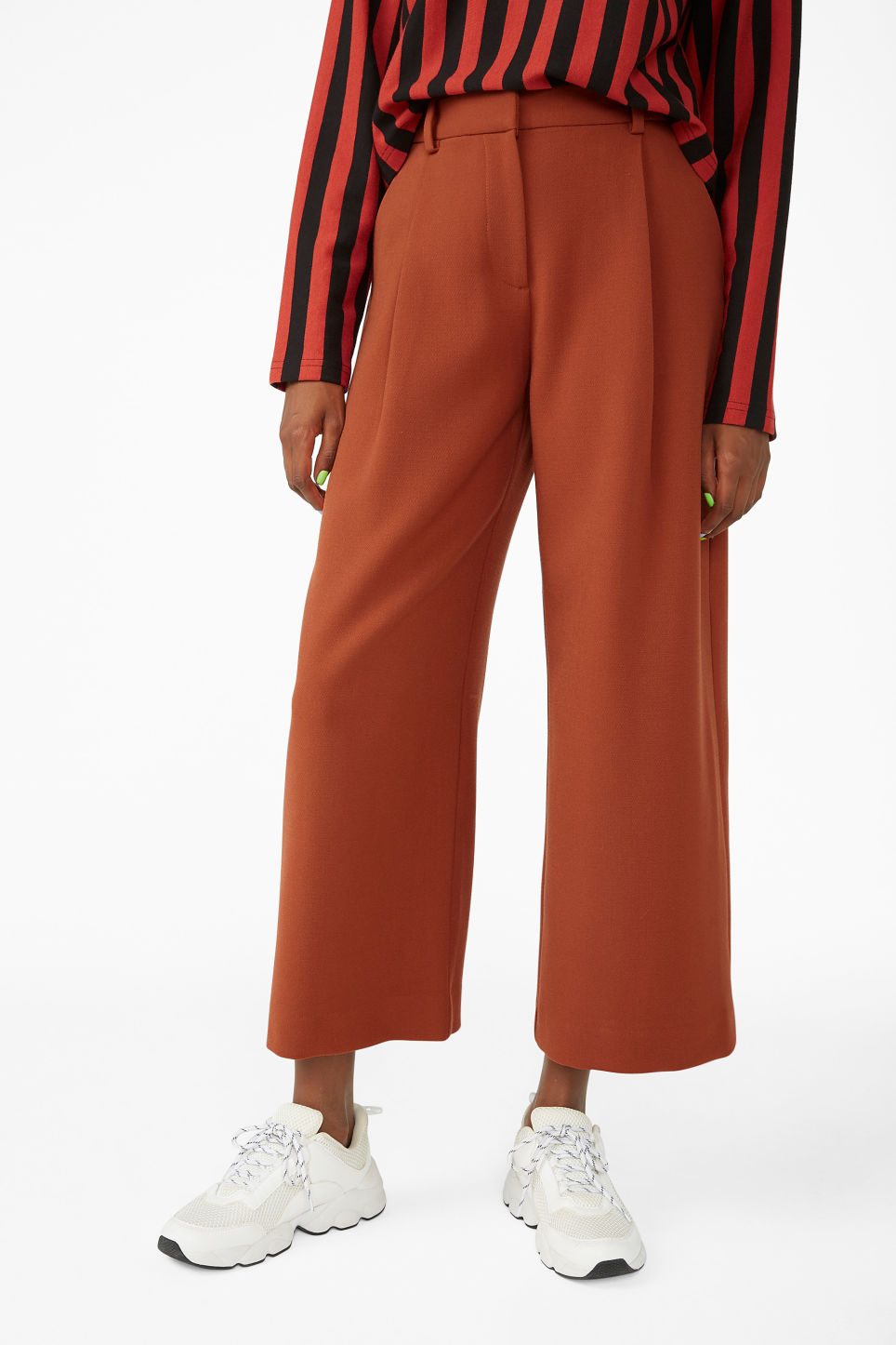 Model side image of Monki wide leg trousers in orange